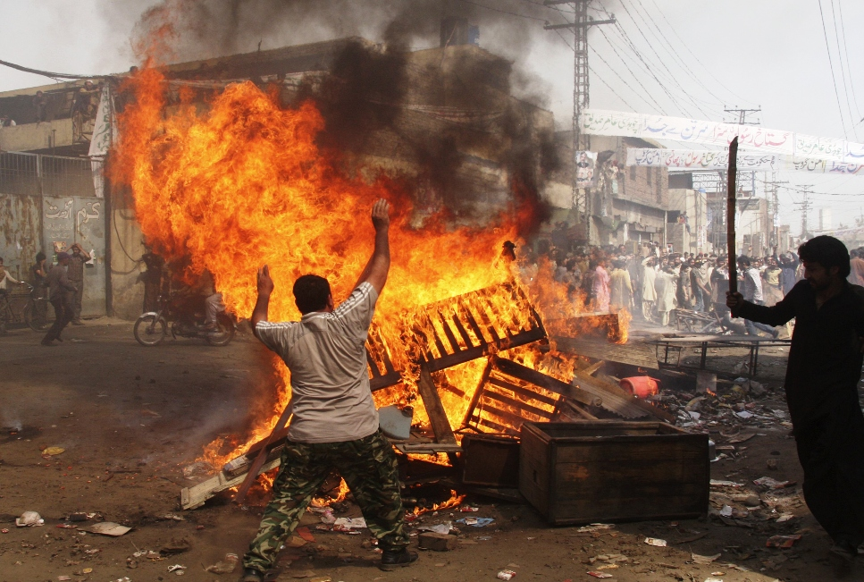Demonstrators burn furniture during a protest in the Badami Bagh area of Lahore March 9, 2013. PHOTO: REUTERS