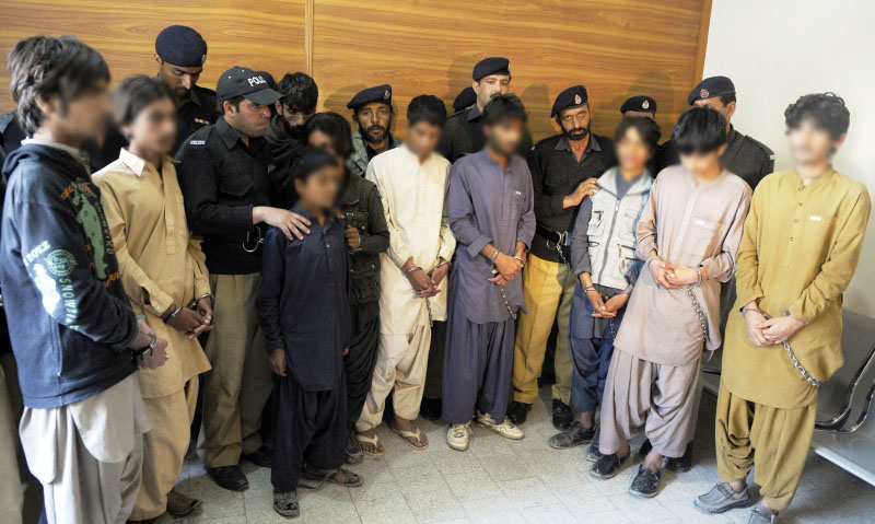 pakistani police produce young children suspected of planting bombs to the media in quetta on march 13 2013 photo afp
