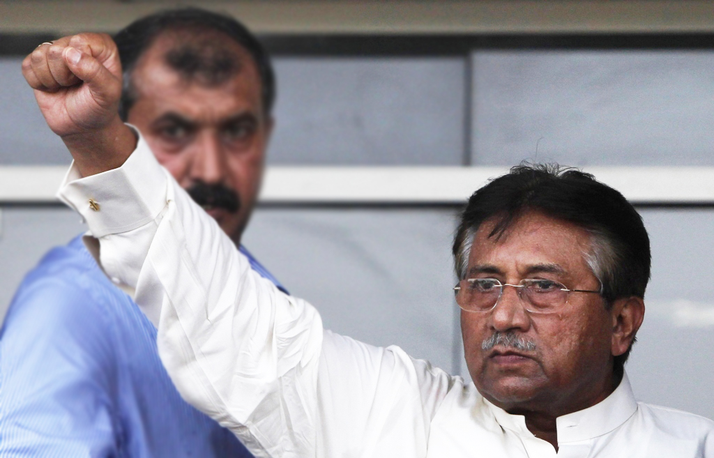 former president pervez musharraf gestures to his supporters upon his arrival from dubai at jinnah international airport in karachi march 24 2013 photo reuters