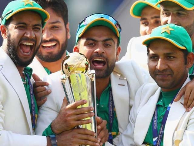 LONDON, ENGLAND - JUNE 18: Sarfraz Ahmed of Pakistan lifts the winners trophy as Pakistan win the ICC Champions trophy cricket match between India and Pakistan at The Oval in London on June 18, 2017. PHOTO: GETTY