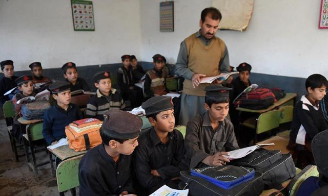 school children attend a class at a school in peshawar photo afp
