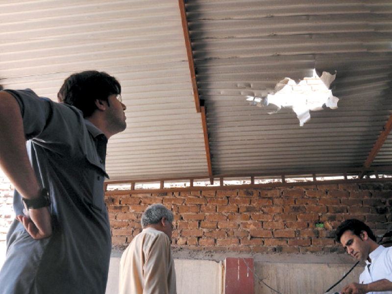 people inspect damages resulting from the attack on the house of pakistan peoples party s na 1 candidate zulfiqar afghani as the polls draw closer militants have increasingly targeted election candidates photo inp