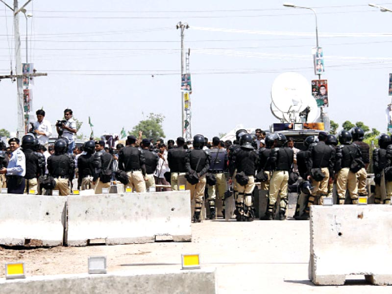 security personnel blocked park road after the general retd musharraf escaped to his farmhouse from the court premises earlier in the day photo muhammad javaid express