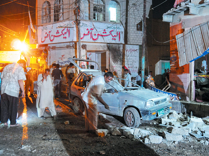 A view of the site after a bomb attack on an MQM office in the Nusrat Bhutto Colony of Karachi. PHOTO: MOHAMMAD NOMAN / EXPRESS