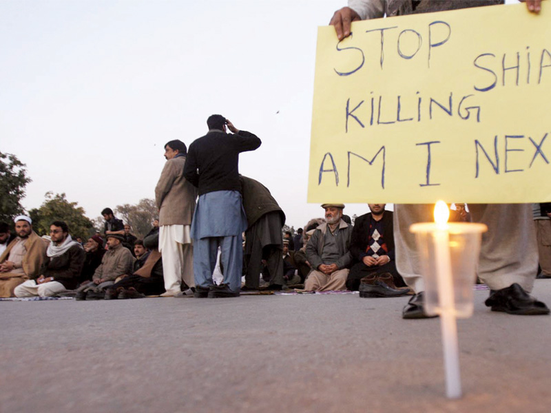 Protesters staged a sit-in in front of the Governor House in Lahore to protest Shia killings. PHOTO: INP/ FILE