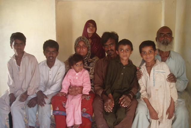 imran second from the right a victim of child trafficking poses with his family in rahim yar khan photo zahid gishkori express tribune