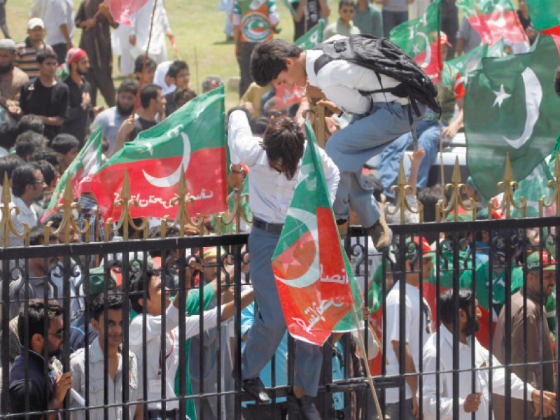 pti supporters climb over the locked gates to enter quaid s mausoleum photo ayesha mir express