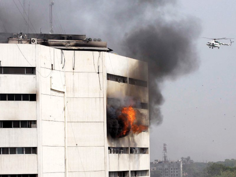 flames and smoke spew out from the seventh floor of the building photo shafiq malik abid nawaz express