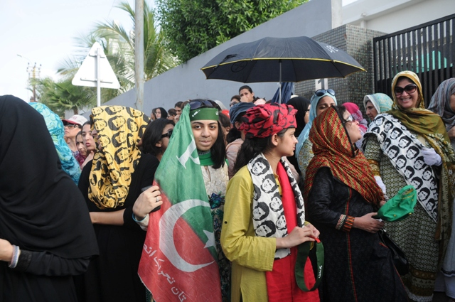 women wait outside dha model school in phase 4 to exercise their right to vote but the polling station was not opened at its stipulated time photo mohammad noman express
