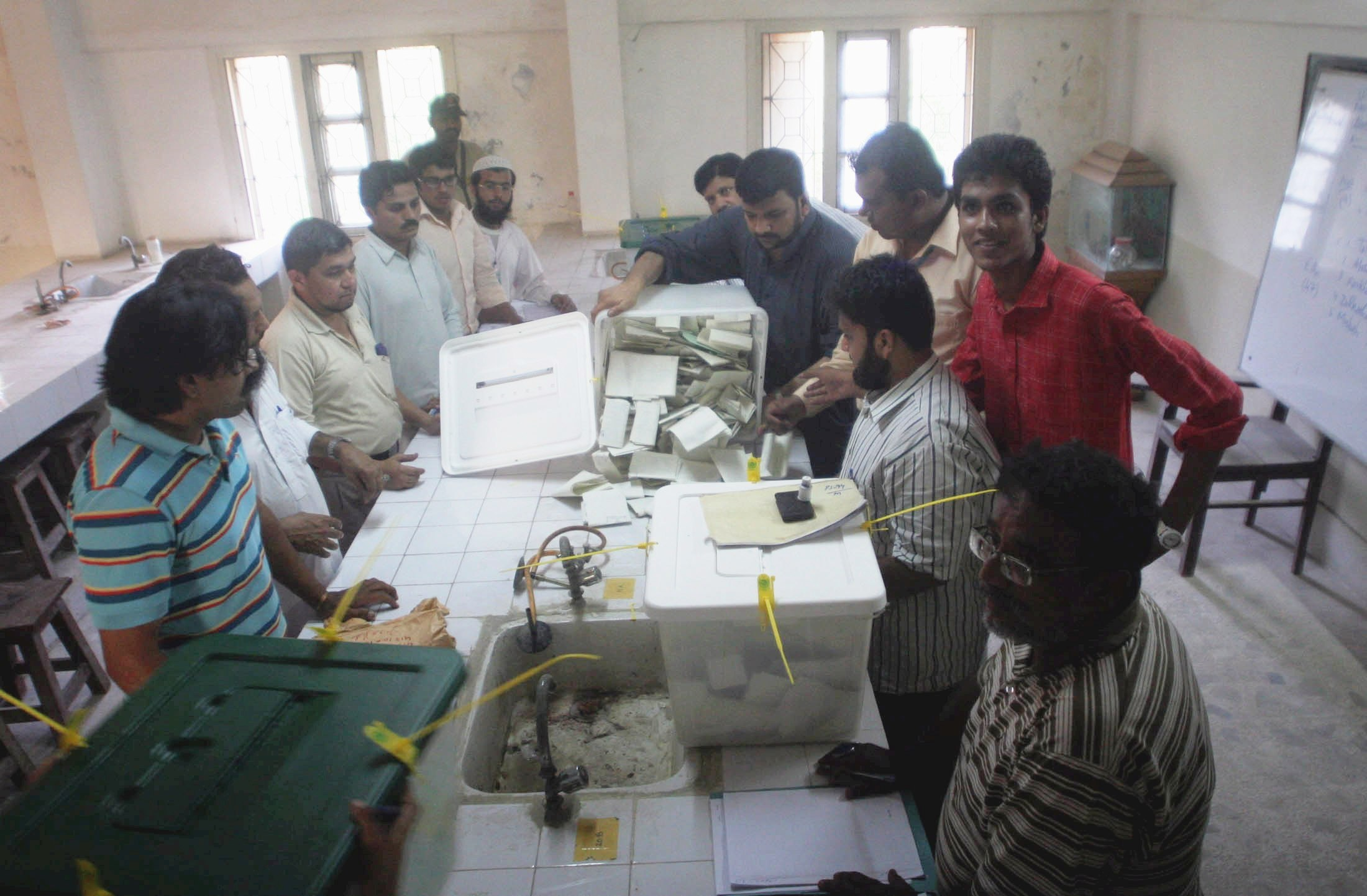 Election officials counting votes in Abdullah Collage after end of the polling time. PHOTO: ATHAR KHAN/ EXPRESS
