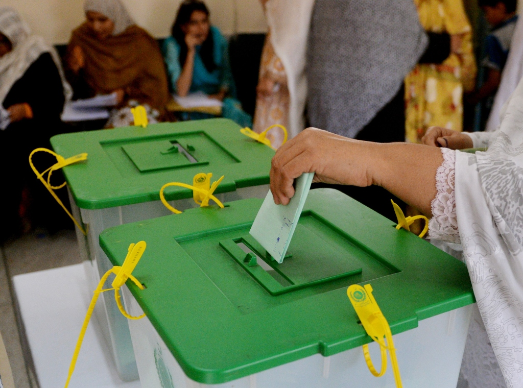The report commends the ECP's efforts to reach out to female voters and set up more polling stations to make reaching them more convenient. PHOTO: AFP