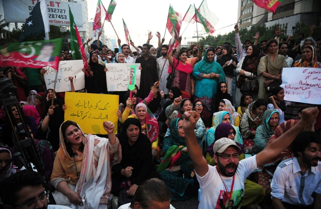 supporters of pakistani politician imran khan shouts slogans during a protest against alleged vote rigging in karachi on may 13 2013 photo afp
