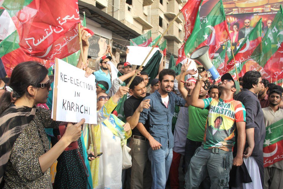in karachi pti activists defied the section 144 imposed by the government and gathered in their hundreds to block the shahrah e faisal in presence of heavily armed police and rangers photo ayesha mir express