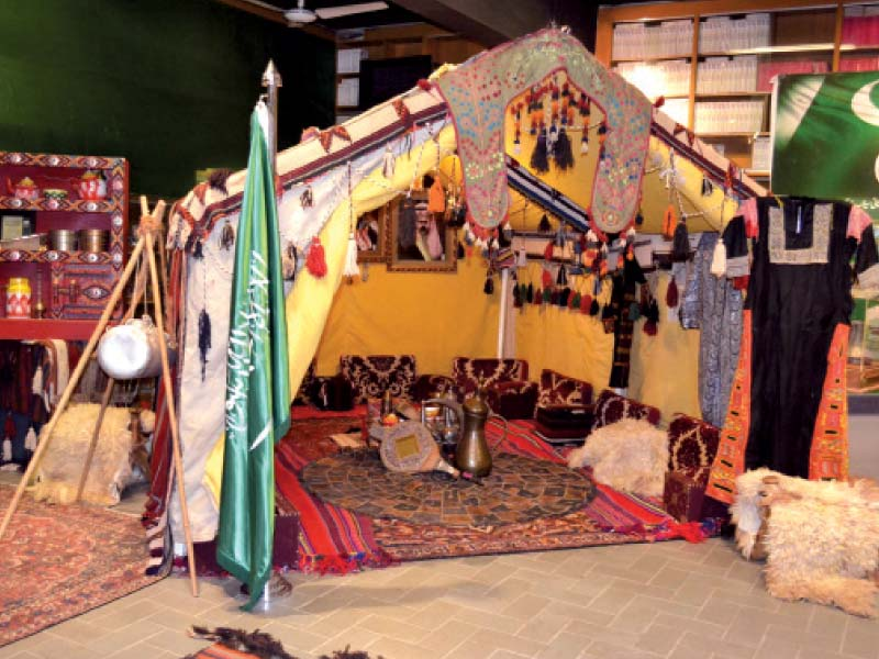 The tent is decorated with intricate rugs, handicrafts and decanters used for pouring qehwa. PHOTO: EXPRESS