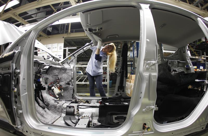 an employee works at the assembly line of the ford car factory of saarlouis december 6 2010 photo reuters