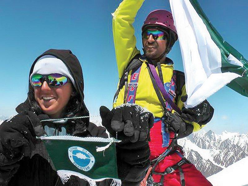 samina 21 besides a flagpost on mount everest nepal photo express