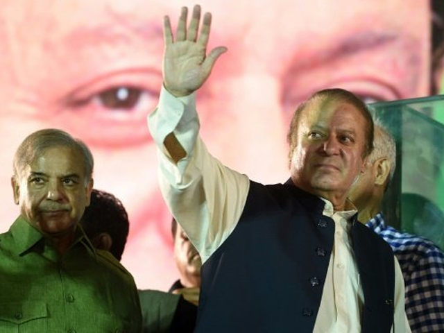 Nawaz Sharif addressing crowds along the route that connects the capital to his party's eastern stronghold after Pakistan's top court deposed him last month following a corruption investigation. PHOTO AFP