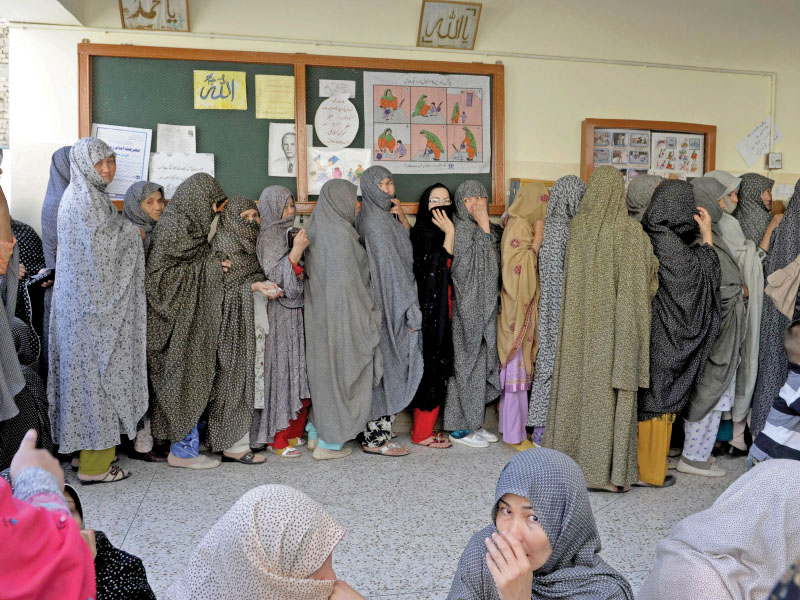 female voters of the hazara community line up to cast their votes photo afp