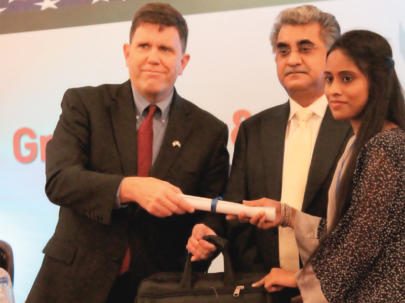 US Consul General Michael Dodman and Sindh education department's secretary Dr Fazlullah Pechuho awarded scholarships to 200 students as part of the USAID's Teachers Education Project on Wednesday. PHOTO: EXPRESS