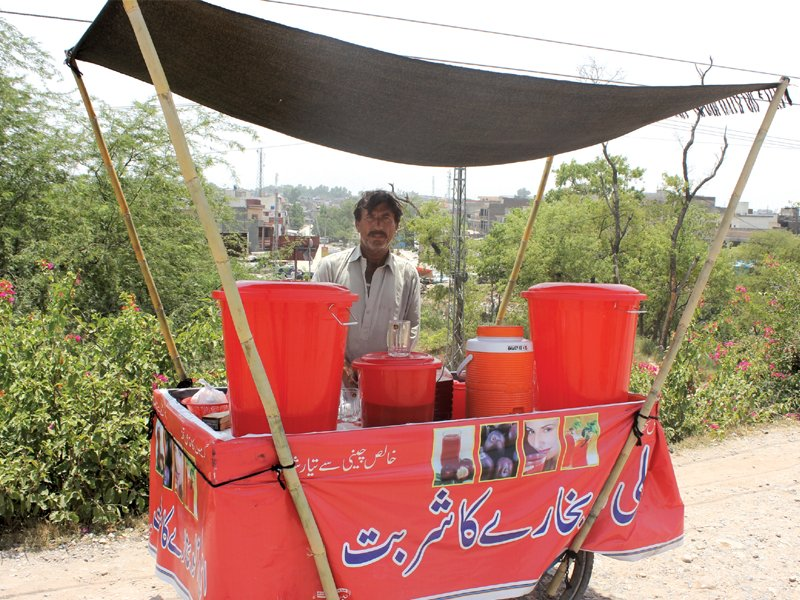 water carriers and juice vendors are in high demand during summers photo waqas naeem express
