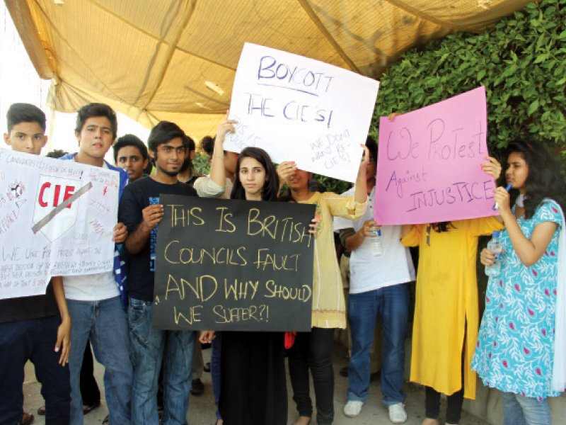 students of st michael s school protest outside karachi grammar school s college campus on tuesday photo ayesha mir express