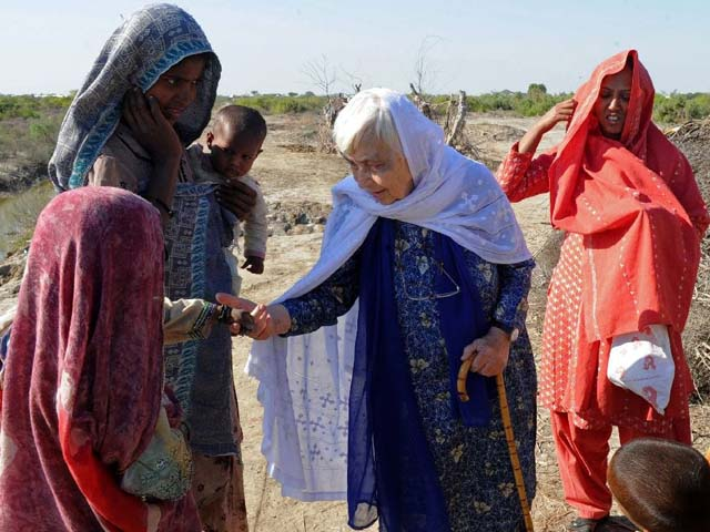 Ruth Pfau (C), head of a Pakistani charity fighting leprosy and blindness, meets people in flood-affected southern Pakistan in December 2010. PHOTO: AFP