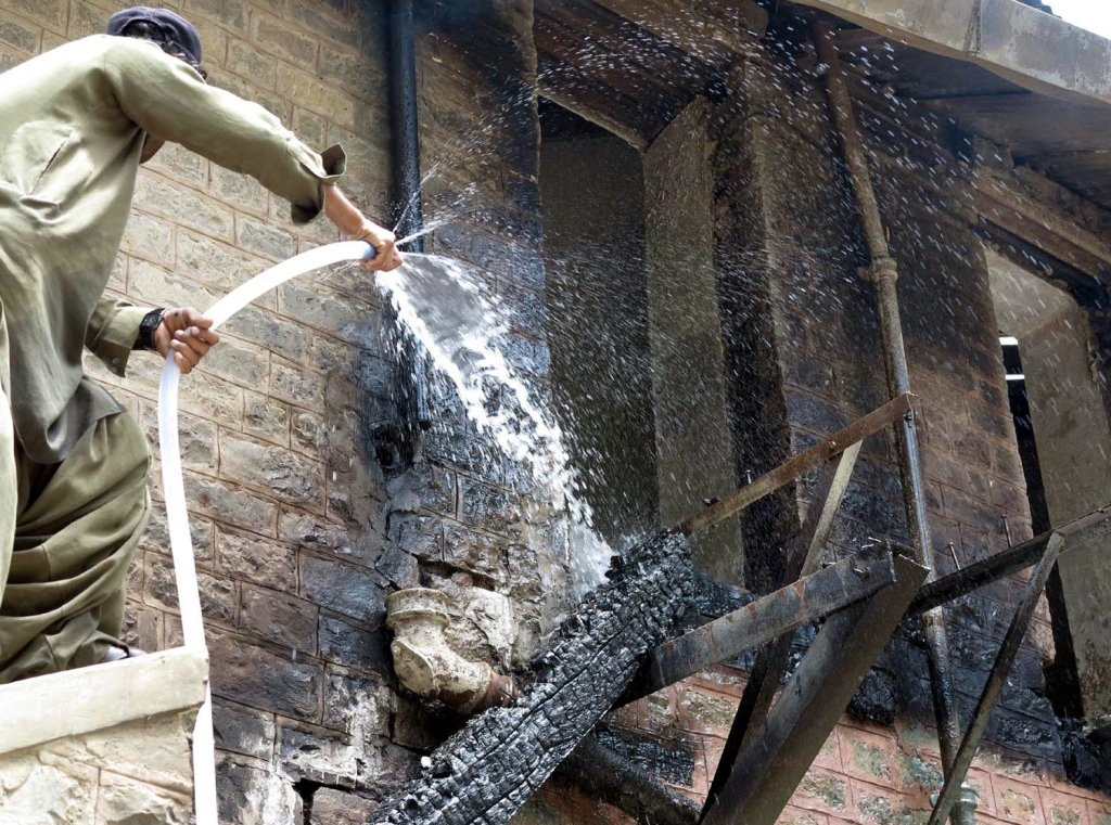fire fighters struggling to extinguish the fire which erupted in quaid e azam 039 s residency in ziarat after militants blew the house up late on friday photo inp