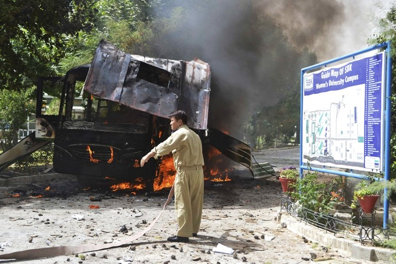a firefighter stands near a burning bus after a bomb attack in quetta june 15 2013 photo reuters