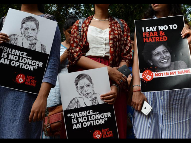 People attend a protest in India against the killing of senior journalist Gauri Lankesh. PHOTO AFP