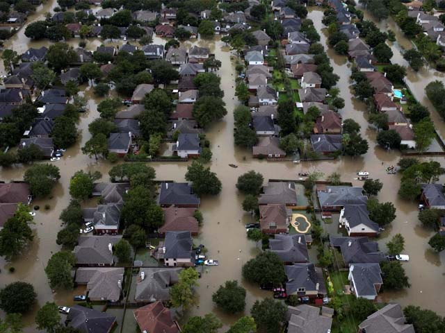 Houses are seen submerged in flood waters caused by Tropical Storm Harvey in Northwest Houston, Texas, U.S. PHOTO: REUTERS