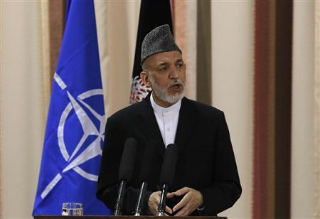 Afghan President Hamid Karzai speaks during a joint news conference following a security handover ceremony at a military academy outside Kabul. PHOTO: REUTERS/FILE
