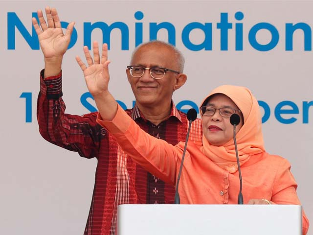 Singapore's President-elect Halimah Yacob and her husband Mohammed Abdullah Alhabshee address supporters before leaving the nomination centre in Singapore September 13, 2017. PHOTO: REUTERS