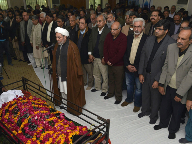 Pakistani relatives and residents offer funeral prayers for author Intizar Hussain during his funeral in Lahore. PHOTO: AFP