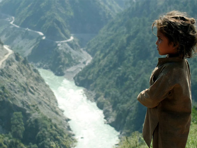 An Indian child is seen near Chenab River about 155 km northwest of Jammu. PHOTO: REUTERS