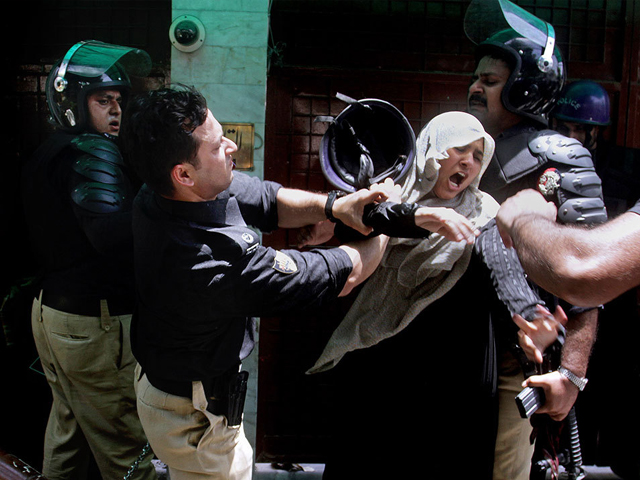 a police officer scuffles with a female protester during clashes in lahore tuesday june 17 2014 photo ap