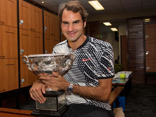 Roger Federer celebrating with the championship trophy inside the locker room after his victory against Spain's Rafael Nadal in the men's singles final on day 14 of the Australian Open tennis tournament in Melbourne on January 29, 2017. PHOTO: AFP