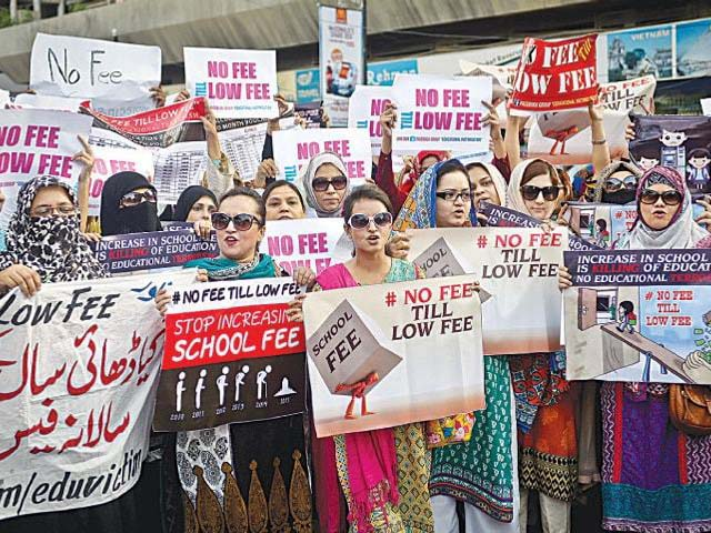 Parents on Tuesday hold a protest demonstration at the Karachi Press Club against recent school fees increase. PHOTO: WHITE STAR