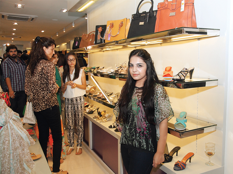 while the shoes and handbags at viss are affordable the brand seems to lack style photo publicity