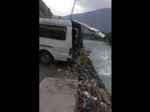 Chitral Health Department is seen disposing off a van full of hospital waste in the already ecologically threatened Chitral River. PHOTO: SCREENSHOT