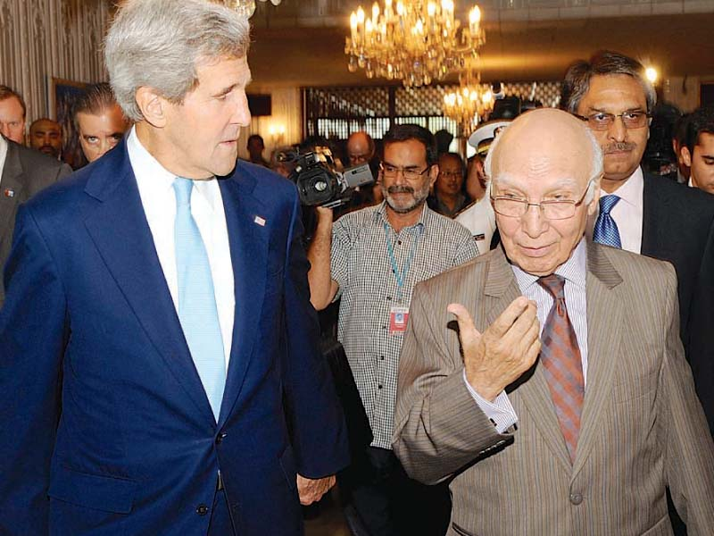 us secretary of state john kerry walks with prime minister s adviser on foreign affairs sartaj aziz before their meeting photo courtesy us state dept