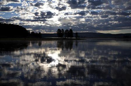 the sunrise is reflected in the yellowstone river in yellowstone national park photo reuters