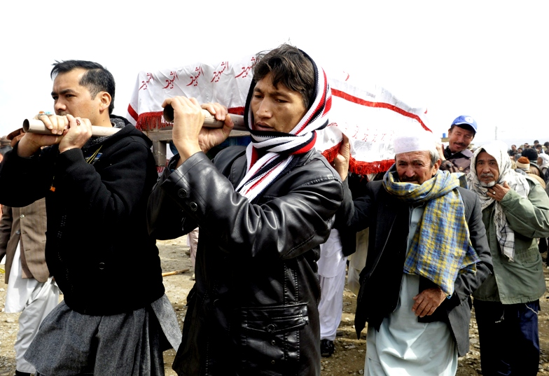 pakistani shia muslims carry the coffins of relatives during a mass burial ceremony in quetta on february 20 2013 photo afp file