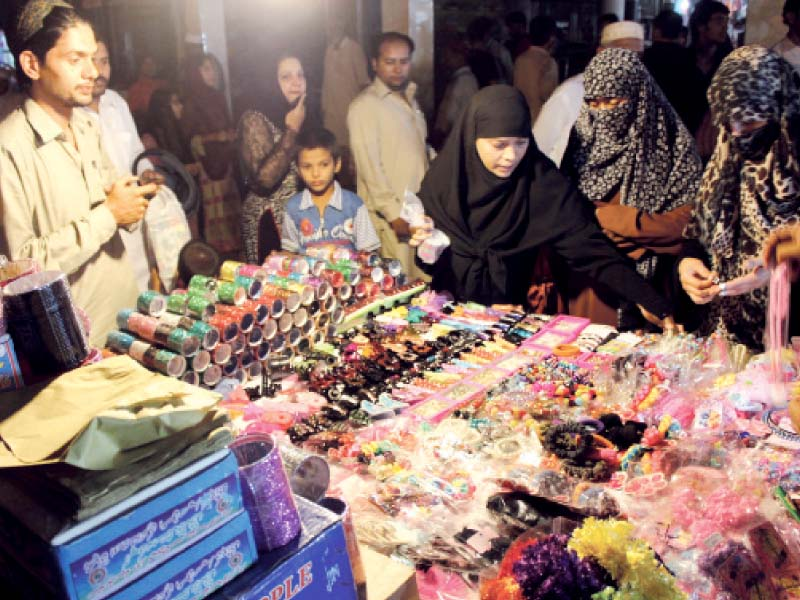 though markets have been flooded with eid customers shopkeepers complain that customers are indulging in more window shopping this time around photo express waqas naeem