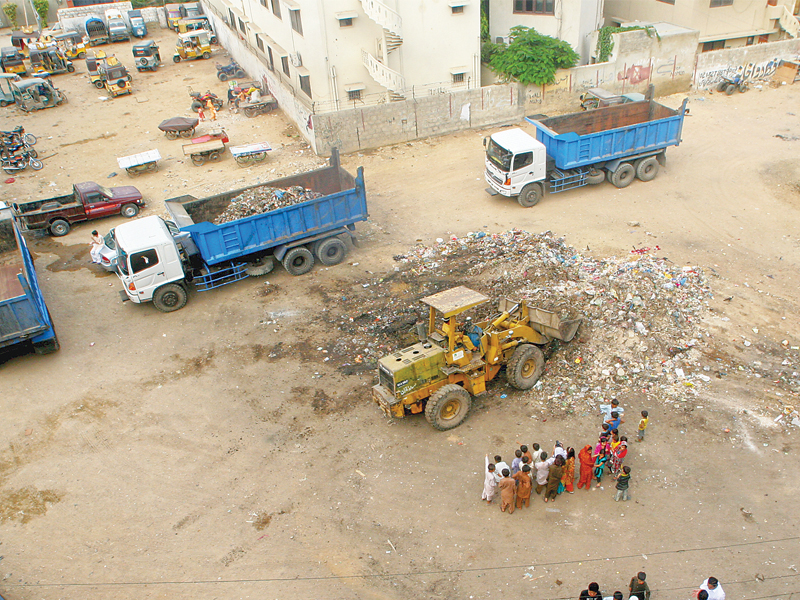 a youth initiative go green approached karachi commissioner and helped initiate a clean up of shah rasul colony in dha the huge piles of garbage were picked up on friday afternoon photo athar khan express