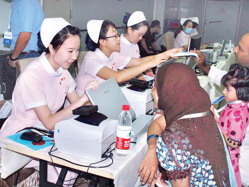 chinese medical staff perform check up on pakistani patients aboard the peace ark on friday nearly 1 800 patients have been treated on the ship since it opened its doors for the public on monday photo app