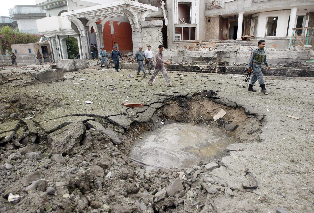 afghan policemen walk near a crater at the site of a suicide attack at the indian consulate in jalalabad province august 3 2013 photo reuters