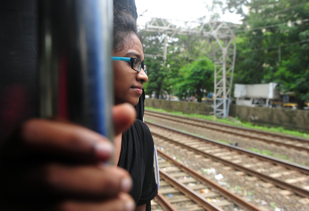 this photo taken on july 27 2013 shows indian woman shweta katti travelling on a suburban train to a fundraiser in mumbai to support her education at new york 039 s bard college photo afp