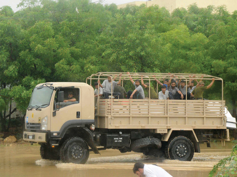The army trucks were sent in to rescue stranded residents from Saadi Town and its adjacent areas. PHOTO: RASHID AJMERI/EXPRESS