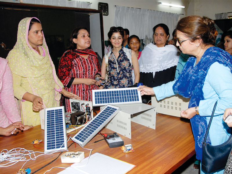 the exhibition displayed solar panels ups silk paintings clay paintings post cards embroidery and clay utensils photo shafiq malik express