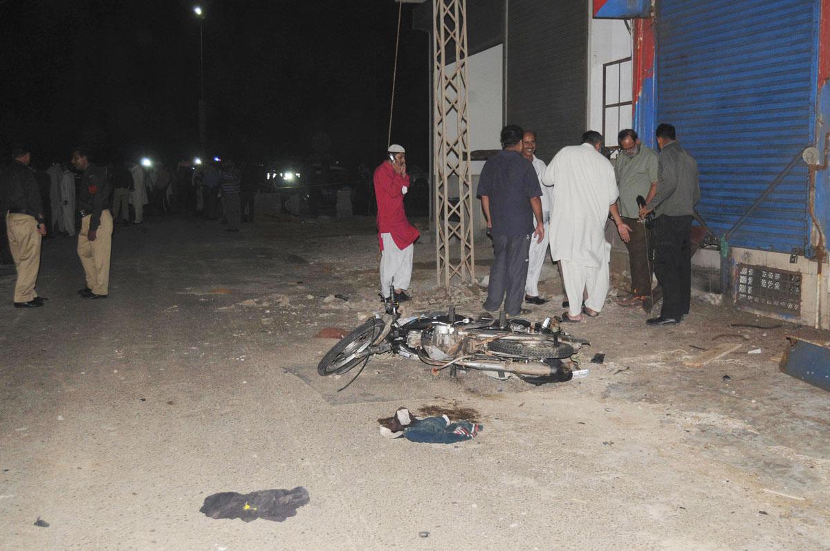 officials gather outside a liquor store on khayaban e muslim after a blast photo mohammmad noman express